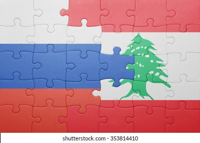 puzzle with the national flag of russia and lebanon . concept