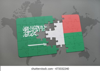 puzzle with the national flag of saudi arabia and madagascar on a world map background. 3D illustration