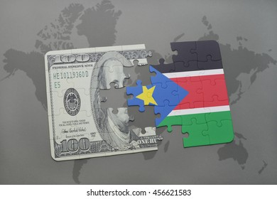 puzzle with the national flag of south sudan and dollar banknote on a world map background. 3D illustration
