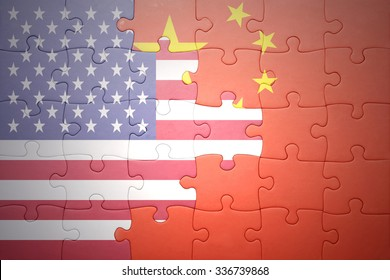 puzzle with the national flag of united states of america and china .concept