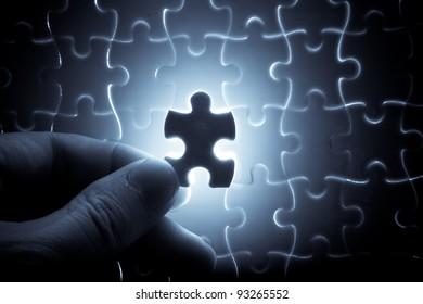 puzzle piece down into place