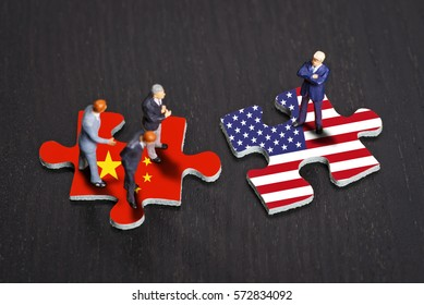 Puzzle pieces with the flags of China and the USA
