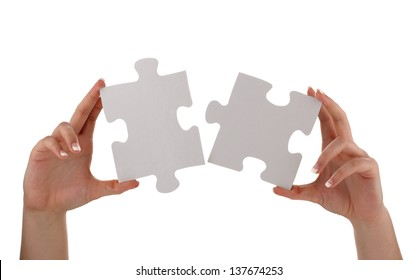 Puzzle pieces joining together concept for unity, teamwork or success with blank white face for message