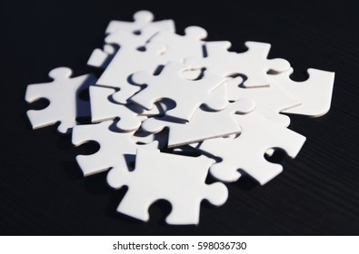 puzzle pieces on black background