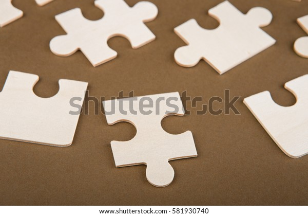 Puzzle pieces on a brown background