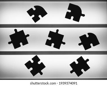 Puzzle pieces on the lighted table