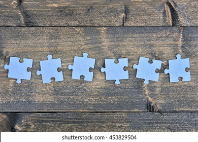 Puzzle pieces on wooden table