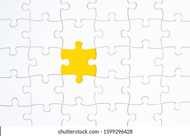 Puzzle Pieces - white with yellow missing space