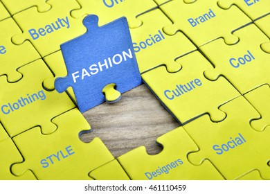 Puzzle pieces with word Fashion
