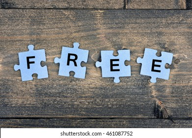 Puzzle pieces with word Free