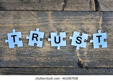 Puzzle pieces with word Trust