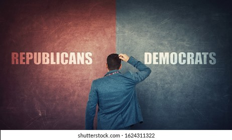 Puzzled businessman and a split wall with Democrats versus Republicans, red vs blue sides. Correct choice, left or right. Difficult decision and doubt concept. Future presidential elections.