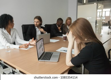 Puzzled focused serious businesswoman thinking concerned about project rates or statistics result looking at laptop screen preparing for group corporate meeting, tired employee feeling headache