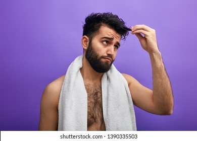 puzzled man has found white hairs after taking shower . depression. man's hair turns white, become stumpy and brittle.Gray Hair