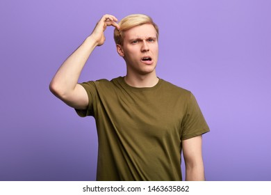 puzzled man scratching head with finger, thinking about something, guy isn't sure in his answer. Human facial expression, emotion, sign body language.