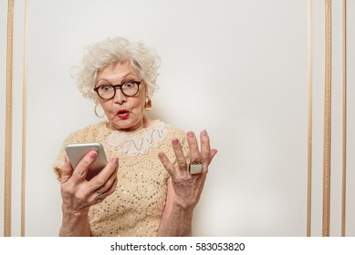 Puzzled old lady does not understand modern technology
