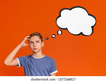 Puzzled teen boy scratching his head and thinking with blank thought bubble, orange studio background
