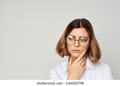 puzzled woman in glasses