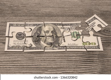 puzzles of American dollar bills on the background of a wooden table. business, Finance, currency.