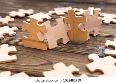 puzzles of wood on the background of a wooden table. puzzle. board game.