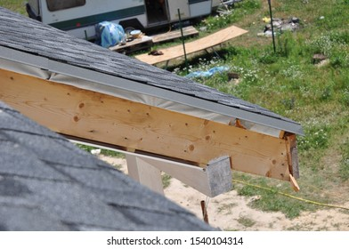 PVC fascia and soffit installation. Close up on Incomplete  Soffit and Fascia Installation. Roofing Construction.