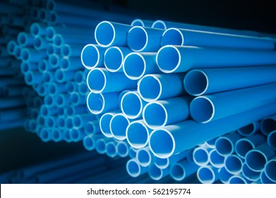 PVC pipes stacked in warehouse ,water