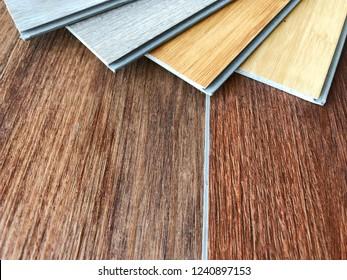 PVC polymer vinyl floor tiles wood planks pattern sample stack on copy space, alternative choice for floor design idea