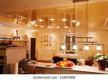 PVC stretch ceiling film with halogen lamps.
