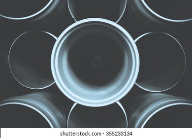 PVC tubes plastic pipes stacked in rows pattern