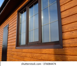 Pvc windows laminated by fog oak with bars in country house