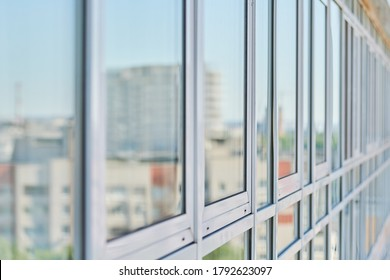 PVC windows on facade of skyscraper. Plastic double glazed windows. Building exterior.