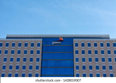 """PwC sign is seen at company office in the downtown of Silicon Valley largest city. PricewaterhouseCoopers is one of the """"Big Four"""" accounting organizations - San Jose, California, USA - June 16, 2019"""