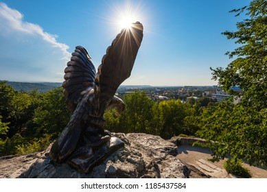PYATIGORSK, RUSSIA - AUGUST 21, 2018: The bronze sculpture of an eagle located in the background of the city in sunny day. Official symbol of the Caucasian Mineral Waters.