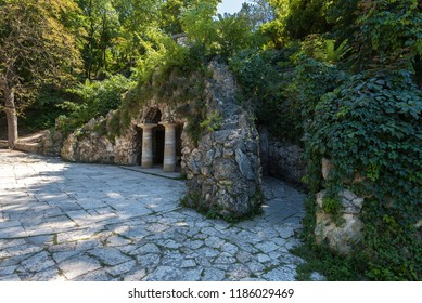 PYATIGORSK, RUSSIA - AUGUST 21, 2018: Old stone grotto of Diana with columns overgrown with green plants. The Dianas Grotto. Flower park. Pyatigorsk landmarks The Northern Caucas