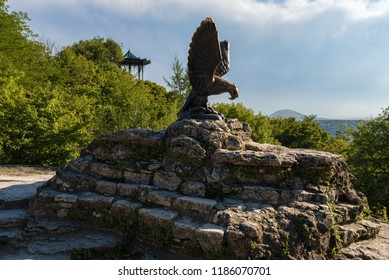 PYATIGORSK, RUSSIA - AUGUST 21, 2018: The bronze sculpture of an eagle fighting a snake on a Mashuk mountain, Pyatigorsk, Russia. Official symbol of the Caucasian Mineral Waters
