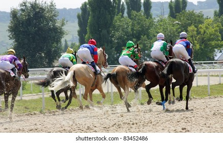 PYATIGORSK, RUSSIA -AUGUST 21: Horses and jockeys race down the track at the start of the race for the prize of Cherkezovoi on August 21, 2011 in Pyatigorsk, Caucasus, Russia.