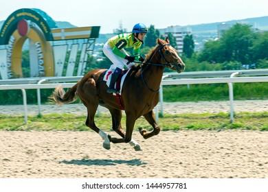 "PYATIGORSK, RUSSIA - JULY 07,2019: Finish horse race of the traditional prize ""Summer"" on Pyatigorsk hippodrome,Northern Caucasus,Russia.Ahead master jockey Guseinov Gusein."