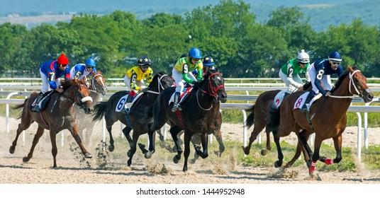 "PYATIGORSK, RUSSIA - JULY 07,2019: Horse race of the traditional prize ""Ogranichitelni"" on Pyatigorsk hippodrome,Northern Caucasus,Russia."