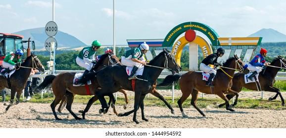 "PYATIGORSK, RUSSIA - JULY 07,2019: Horse race of the traditional prize ""Jockey club"" on Pyatigorsk hippodrome,Northern Caucasus,Russia."