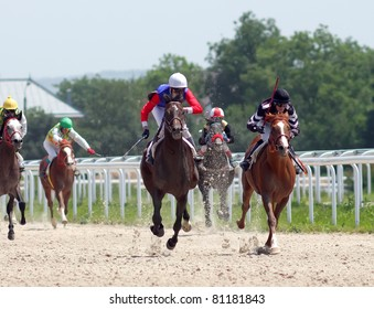 PYATIGORSK, RUSSIA - JULY 17: Jockeys (L - R) Mardanov,Saitgaleev,Stepakin, Kardanov and Guseinov race for the prize of Asuana hippodroma on July 17, 2011 in Pyatigorsk, Caucasus, Russia.