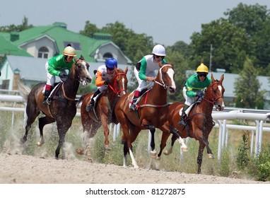 PYATIGORSK, RUSSIA - JULY 17: Jockeys (L - R) Mardanov,Saitgaleev,Batirov and  Kardanov race for the prize of Ogranichitelni hippodroma on July 17, 2011 in Pyatigorsk, Caucasus, Russia.