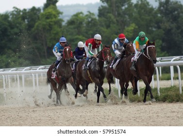"PYATIGORSK, RUSSIA  - JULY 25: The race for the prize of the ""Derby"";The jockeys Suhanov,Smirnov,Kappushev and Avidzba; July 25, 2010 in Pyatigorsk; Caucasus; Russia."
