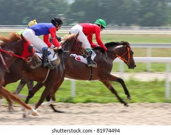 PYATIGORSK, RUSSIA - JULY 31:Jockeys(L - R) Shamil Guseinov and Pavel Stepakin race for the prize of Tarashi  on July 31,2011 in Pyatigorsk, Caucasus, Russia.