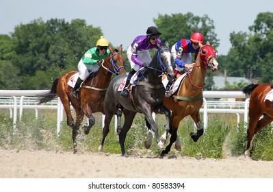 PYATIGORSK, RUSSIA - JULY 4: Jockeys (L - R) Mardanov, Hatkov and Guseinov race for the prize of the Ogranichitelni on July 4, 2011 in Pyatigorsk, Caucasus, Russia.
