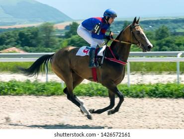 PYATIGORSK, RUSSIA - JUNE 16,2019: Horse race of the traditional prize Big Summerl on Pyatigorsk hippodrome.Ahead master jockey Guseinov Gusein.
