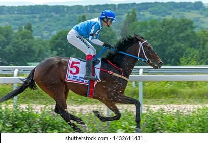 "PYATIGORSK, RUSSIA - JUNE 23,2019: Finish horse race of the traditional  prize 'Otkritia"" on Pyatigorsk hippodrome,Northern Caucasus,Russia."