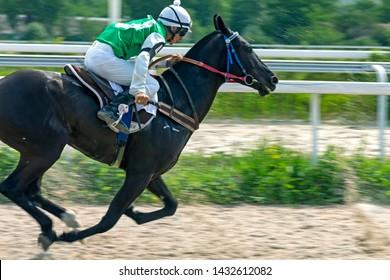 """PYATIGORSK, RUSSIA - JUNE 23,2019: Horse race of the traditional  prize 'Super-Sprint"""" on Pyatigorsk hippodrome - ahead Pshukov Islam on brown stallion Talant-Ser."""