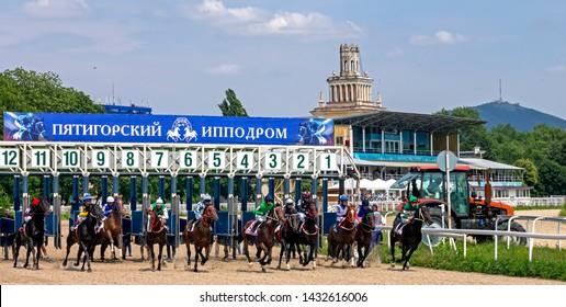 "PYATIGORSK, RUSSIA - JUNE 23,2019: Start horse race of the traditional prize ""Avins wuda"" on Pyatigorsk hippodrome,Northern Caucasus,Russia."