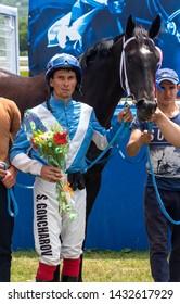 PYATIGORSK, RUSSIA - JUNE 23,2019:Winner of the Kuban River Prize at the Pyatigorsk Hippodrome - master jockey Goncharov Stanislav and brown mare Sitara.