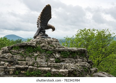 PYATIGORSK, RUSSIA - MAY 19, 2016: The bronze sculpture of an eagle fighting a snake on a Mashuk mountain, Pyatigorsk, Russia. Official symbol of the Caucasian Mineral Waters